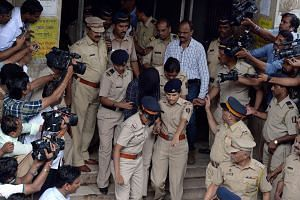 Indian police escort former media executive Indrani Mukherjea from a city court in Mumbai on Aug 31, 2015.