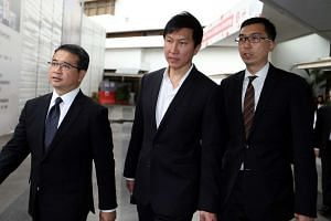 Kong Hee leaving the State Courts with his Lawyers.