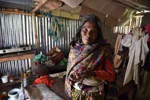 76-year-old Chhali Maya Lama had to stay in the chicken coop for a few months after her house was destroyed by the earthquake. She now lives in a shelter provided by the Rotary Club.