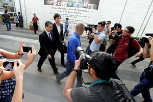 Kong Hee and his lawyer Edwin Tong arriving at the State Courts on Nov 20.