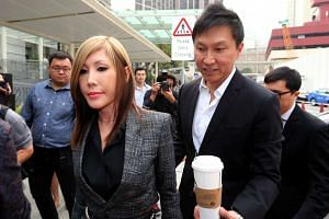 City Harvest Church founder, Kong Hee and his wife Ho Yeow Sun arriving at the State Courts on Oct 21, 2015.