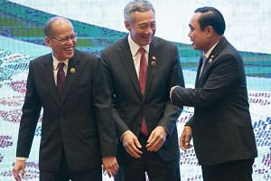 (From left) Philippine President Benigno Aquino, Singapore Prime Minister Lee Hsien Loong and Thai Prime Minister Prayut Chan-o-cha at the Asean Summit in Kuala Lumpur on Nov 21.