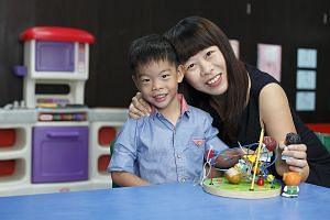 Ms Jeannette Seah and her son, Joash, four, who had a successful foetal surgery performed on him when he was in the womb.