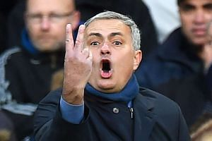 Chelsea manager Jose Mourinho reacts during the match.