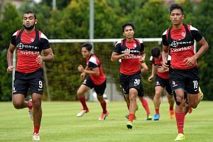 Khairul Nizam (No. 10) during a LionsXII training session on Nov 20. His return from a knee injury brings the dual benefit of aerial power and physical strength as he presses his claims for a starting place in the side that will play the first leg of