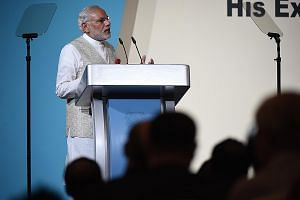 Indian Prime Minister Narendra Modi speaking at the 37th Singapore Lecture at the Shangri-La Hotel yesterday, attended by an audience of more than 1,000, including students (far right) from DPS International School, an Indian international school in