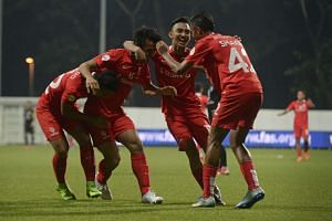 LionsXII's Shahdan Sulaiman (second from left) celebrates with teammates during the Malaysian Cup match on Oct 17, 2015.