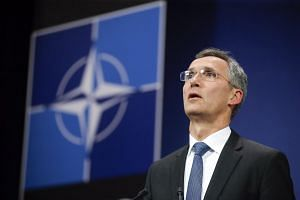 Nato chief Jens Stoltenberg speaking at a press briefing after an emergency meeting on Nov 24, 2014.