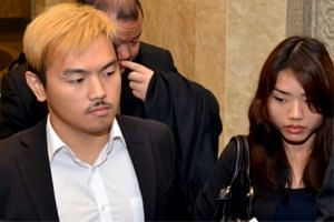 Controversial Malaysian sex bloggers Alvin Tan (left) and Vivian Lee leaving the Court in Kuala Lumpur, Malaysia.