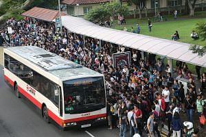 Commuters queuing at a bus stop opposite Bishan MRT Station for free shuttle buses. Train services between the Yishun and Bishan stations in both directions were disrupted for nearly two hours from 5.45am yesterday, affecting more than 70,000 commute