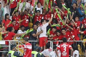 FIRST GOAL: The LionsXII's Baihakki Khaizan celebrating with delighted fans, after opening accounts during the team's 1-2 loss in their first MSL match against Kelantan on Jan 10, 2012 at the Jalan Besar Stadium.