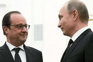 Putin (right) and Hollande meeting at the Kremlin in Moscow.