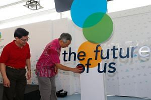 PM Lee (right) at the opening of the Future of Us exhibition.