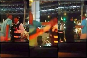 Uber driver Goh Kok Ling (main picture) showing the injuries that he sustained from his clash with an LTA enforcement officer at a Bugis Junction taxi stand last Friday. Above: Stills from video footage of the fight, which was eventually broken up by