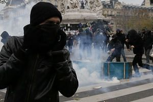 Demonstrators clash with French riot police during protests on Place de la Republique, ahead of the COP21 World Climate Change Conference 2015 in Paris, France, on Nov 29, 2015.