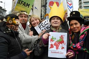 Actress Emma Thompson (third from left) with fashion designer Vivienne Westwood (second from right) and indigenous South Americans during a march in London on Sunday.