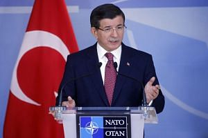 Turkish Prime Minister Ahmet Davutoglu delivered a press briefing after a meeting in Belgium on Nov 30.