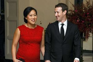 A pregnant Priscilla Chan with husband Mark Zuckerberg attending a White House event on Sept 15, 2015.