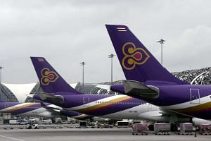 A file picture dated Jun 26, 2014, shows Thai Airways aircraft lined up at Suvarnabhumi International Airport in Bangkok, Thailand.