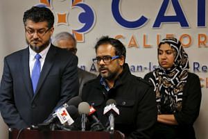 Farhan Khan (centre), brother-in-law of San Bernardino shooting suspect Syed Farook, speaks at the Council on American-Islamic Relations in Anaheim, California on Dec 2, 2015.