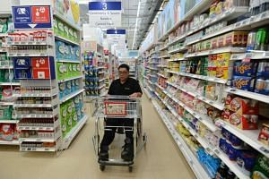 The supermarket at the Enabling Village features lower shelves and wider aisles as well as assistive devices and help buttons.