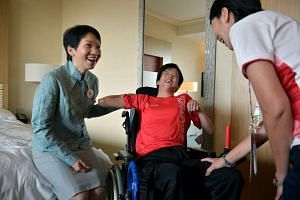Minister for Culture, Community and Youth Grace Fu speaking with Asean Para Games boccia team member Toh Sze Ning during her tour of the Marina Bay Sands Games Village, as Dr Teo-Koh Sock Miang (right), the president of the Singapore Disability Sport