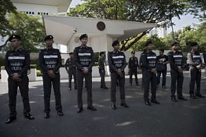 Police officers securing the entrance of the US embassy in Bangkok on Nov 27.