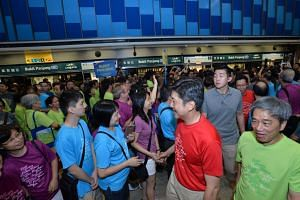Senior Minister of State for Transport, Mr Ng Chee Meng meeting commuters at the Bukit Panjang Downtown Line 2 station