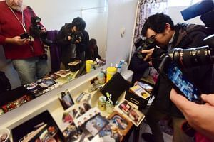 Journalists take photos inside the bathroom in the home of shooting suspect Syed Farook.