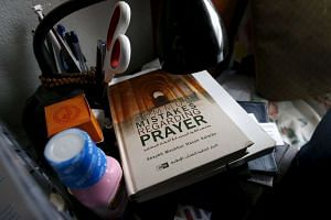 A book is shown inside the home of suspects Syed Rizwan Farook and Tashfeen Malik in Redlands, California.