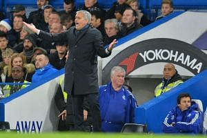 Mourinho reacts during the match which Chelsea lost to Bournemouth 1-0.