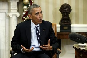 US President Barack Obama speaks about the shootings in San Bernardino, California during a meeting with his national security team in Washington Dec 3, 2015.