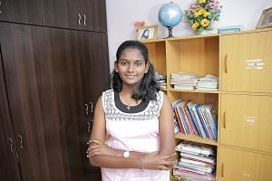 Natarajan Anitha Phireethi, 13, credits her tutors at Sinda's tuition programme for helping her ace last year's Primary School Leaving Examination. The former Lianhua Primary School pupil scored four A*s and is now a student at Raffles Girls' School