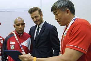 David Beckham and cerebral palsy footballer Khairul Anwar Kasmani watching as Sport Singapore chief executive Lim Teck Yin showed them highlights of the Singaporean's long-range stunners made during the ongoing Asean Para Games.