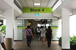 Visitors at the entrance of Block 4 at Singapore General Hospital.