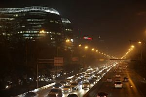 Vehicles on the Second Ring Road during the evening rush hour amid the heavy smog in Beijing, China on Dec 7, 2015.