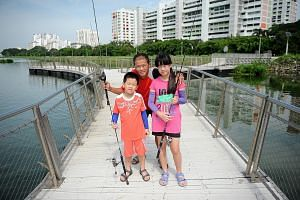 Mr Yong Choon Wee with his children Anders and Angel on an outing at Pandan Reservoir two weeks ago. Mr Yong, who was diagnosed with pulmonary arterial hypertension seven years ago and was given 10 years to live, went on a fishing trip to the Souther