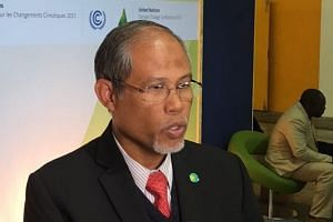 Singapore's Minister for the Environment and Water Resources, Mr Masagos Zulkifli, speaks outside the plenary at the Paris climate summit.