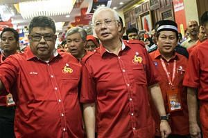 Prime Minister Najib Razak arrives for the UMNO General Assembly at the PWTC in Kuala Lumpur, Malaysia, Dec 8, 2015.