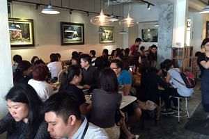 Strangers' Reunion (above) was packed at lunchtime yesterday after the cafe posted on Facebook that they would be open on Tuesdays to help raise funds for their cancerstricken head chef Sebastian Tan.