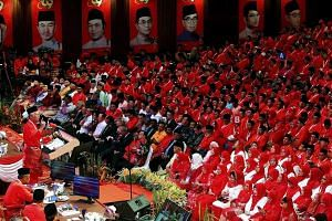 Prime Minister Najib Razak, the Umno president, delivering his keynote address at the 69th Umno General Assembly in Kuala Lumpur yesterday.