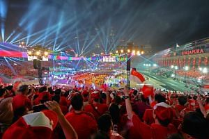 Spectators at the Padang enjoying the spectacular pyrotechnic display during the finale at the National Day Parade on Aug 9, 2015.