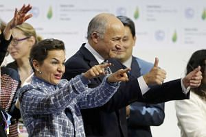 French Foreign Affairs Minister Laurent Fabius (right) and UN top climate change official Christiana Figueres (left) react during the session.