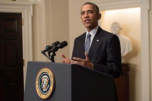 US President Barack Obama speaking at the White House after the climate pact was reached. While he hailed the deal, the Republican presidential candidates' silence highlighted the political divide on the issue.