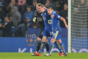 From left to right, Leicester City's goalkeeper Kasper Schmeichel, defender Christian Fuchs and midfielder Marc Albrighton celebrate after winning their EPL match against Chelsea in Leicester on Monday.