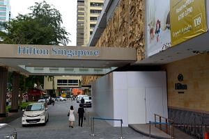 The main entrance to the Hilton Singapore has been completely boarded up.