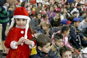 Iraqi and Syrian refugee children celebrate Christmas during a ceremony hosted by His Beatitude Archbishop Michel Qasarji, Diocese of Chaldeans in Babdaa, Lebanon on Dec 19, 2015.