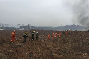 Rescuers searching for survivors at the site of a landslide at an industrial park in Shenzhen, Guangdong province, on Dec 20, 2015.