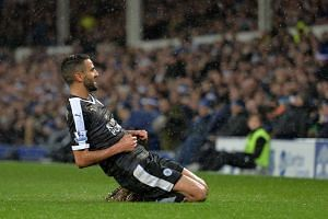 Riyad Mahrez celebrates after scoring.