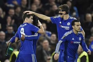 Chelsea's Oscar (left) is congratulated by team mates after scoring a penalty.